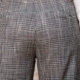 Pantalon large à carreaux en gabardine stretch